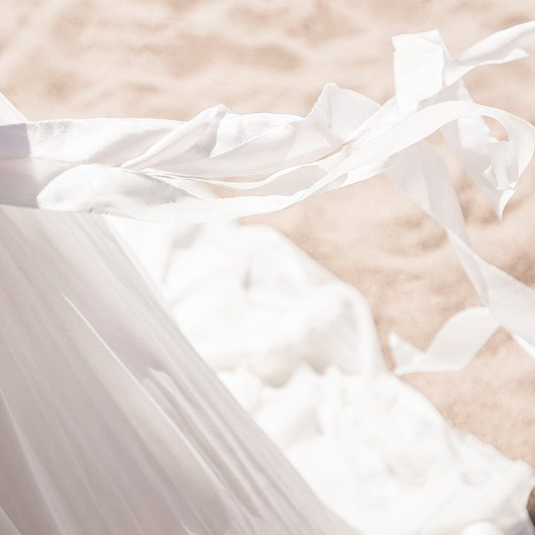 White silk ribbons blowing in the breeze | Image copyright Mel Brown Weddings